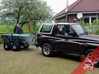 multifunctional trailer profi worker behind SUV